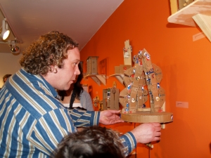Doug Hill demonstrates a robotic hand design at Binding Forces, PCA 2008.