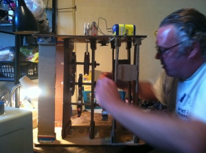 Doug Hill working on a battery-powered version of one of his clocks.