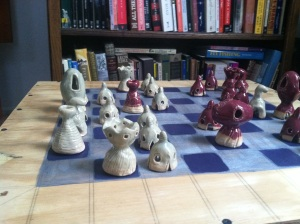 Chess Set, glazed ceramic pieces, wooden board.