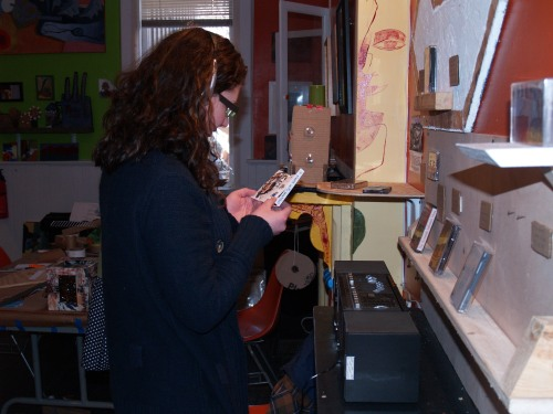 A visitor listens to music during the exhibition, MIXTAPE.