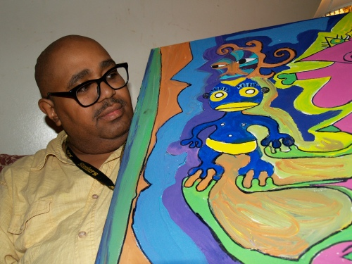 Steve Smith with one of his paintings.
