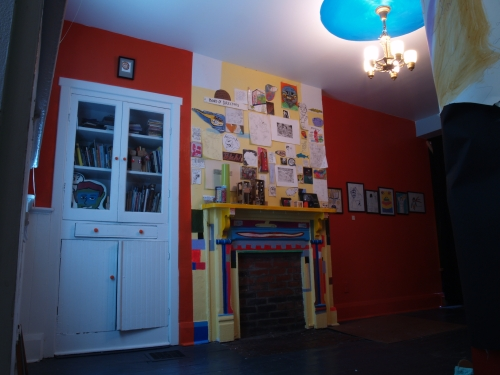 Fireplace.  Show of drawings by Mr. Funky on right.