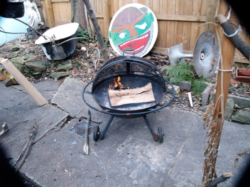 Backyard fire pit used for outdoor cooking.