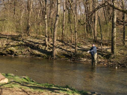 An angler on Yellow Breeches Creek, Central Pennsylvania.  The Fishing report covered trout fishing throughout the state.