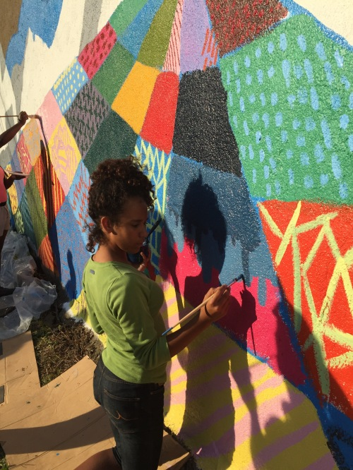 A group of teenage girls from the East Deutschtown neighborhood assisted in painting the foreground of the mural during a workshop.