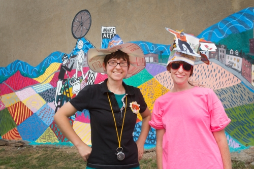 Laura Ramie from Pittsburgh Center for Creative Reuse and volunteer Amy Masters ran the Hat Making area.