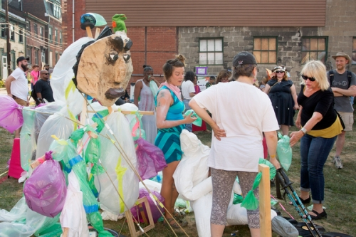 Led by artist Hyla Willis, team Huff & Puff invited audience members into the square to assist in creating inflated plastic bag forms.